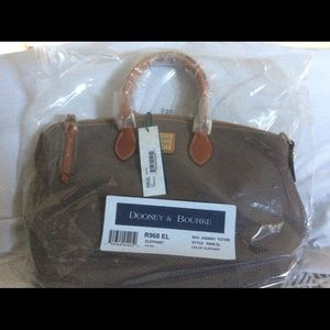 Dooney Bourke 1975 hand bag. (NEW)Style R968 EL